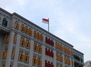 Singaporean flag on top of the Ministry of Information, Communication and the Arts, formerly Singapore's first police station.