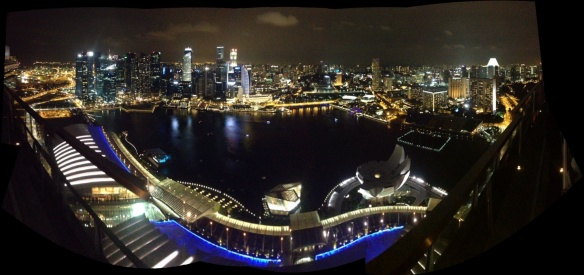 Panoramic view from the 57th level of Marina Bay Sands at night.