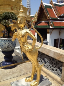 One of the golden statues of a creature from Thai mythology.