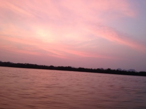 The sun turning the sky a beautiful shade of pink on the boat ride home.