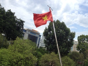 Vietnamese flag out the front of the Ho Chi Minh City Museum.