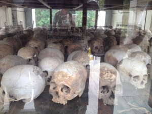 Broken and shattered skulls of victims, now housed in a memorial shrine.