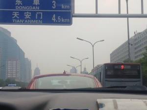 The view of the smoggy streets from my taxi.