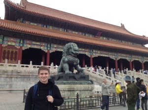 Standing with a lion statue inside the Forbidden City.