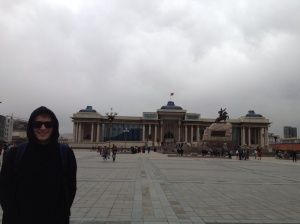 In Sukhbaatar Square, with the Mongolian Parliament House in the background.