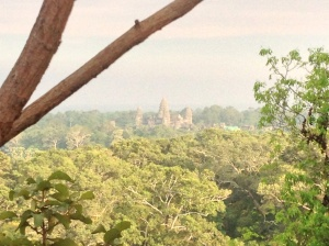 View of Angkor Wat from the base of the sunset ruins.