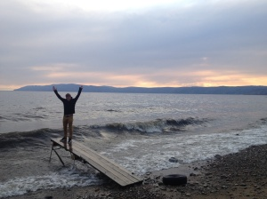 On the shores of Lake Baikal, with the sun sinking behind the horizon.