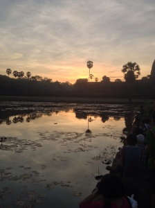 Reflection of the sunrise on the Angkor Wat pool.