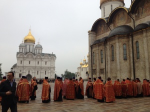 The crowd of priests who were standing around in the grounds of the Kremlin.