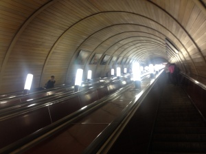 The long, cavernous escalator tunnel in one of the Moscow Metro stations.