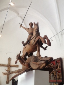 Wooden statue of St George slaying the dragon of legend.
