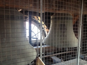 The bells inside the old wooden interior of the tower.