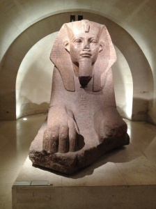A Egyptian sphinx statue.