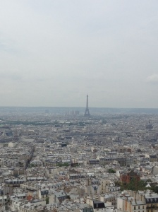 That's the Eiffel Tower as seen from Sacré Cœur, showin just how huge the city really is.