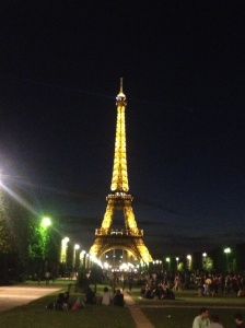 Nighttime view of the Eiffel Tower from the Champs de Mars.