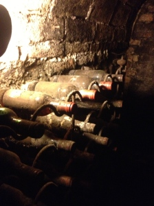 Dusty old wine bottles in the cellar.