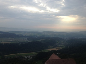 The sun setting behind the clouds, as seen from Uetliberg.