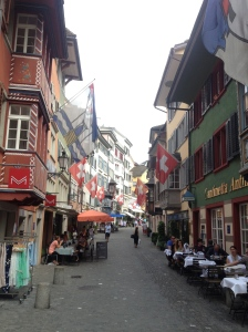 A cute little Swiss street that is obviously very proud to be a Swiss street.