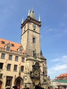 The Old Town Hall tower in the light of day, with the astronomical clock at the bottom.