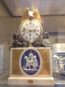 An old clock adorned with sphinxes and a golden eagle.