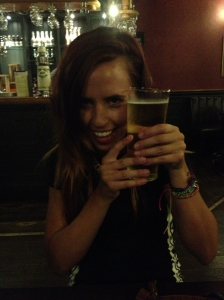 A cheeky Ellie with her pint of cider.