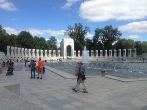 The fountain creates a serene and peaceful mood in the memorial.
