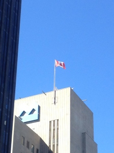 The Canadian flag flying high in Montreal.
