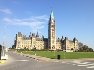 The Centre Block and the Peace Tower of Parliament Hill, with the maple leaf proudly blowing in the wind.