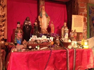 Model alters on display in the voodoo museum.